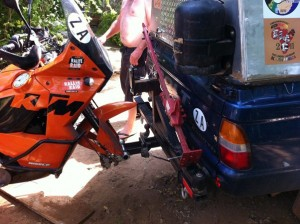 Charles of team 2 wheelers attaches his bike with this well-engineered bracket to their support vehicle in order to give the bottom end of his back some well needed rest…..