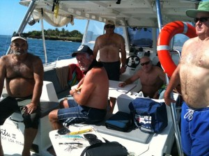 The guys ready to fish and dive – see Mark on the right filling his lungs