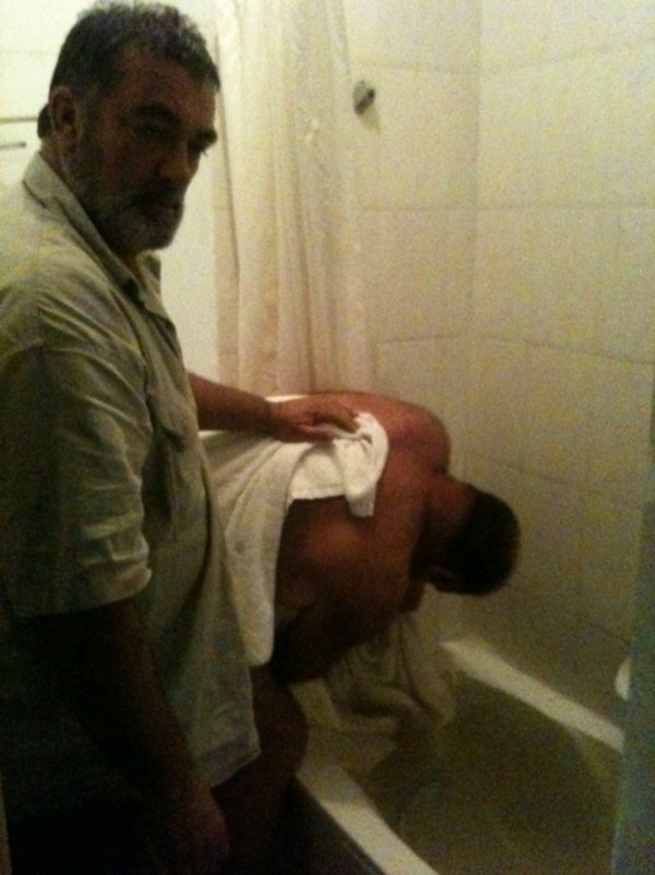 Andre desperately trying to plug 2 open water supplies whilst Rene runs out of towels to shield his body from the eyes of the local plumbing society