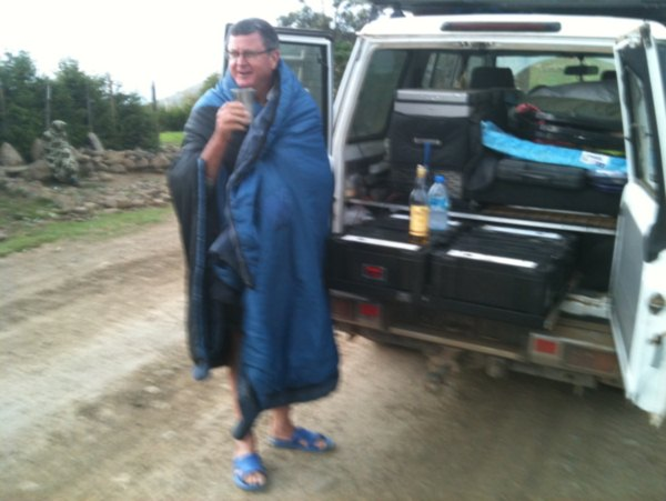 Mark using his sleep bag dress and some white horse and water liquids whilst waiting for team Lipstick's negotiation skills to open the gates of the Simiens  mountain park
