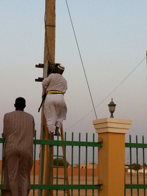 Sudanese electrician at work in full uniform  - no electricity – no aircon –no aircon no sleep…..