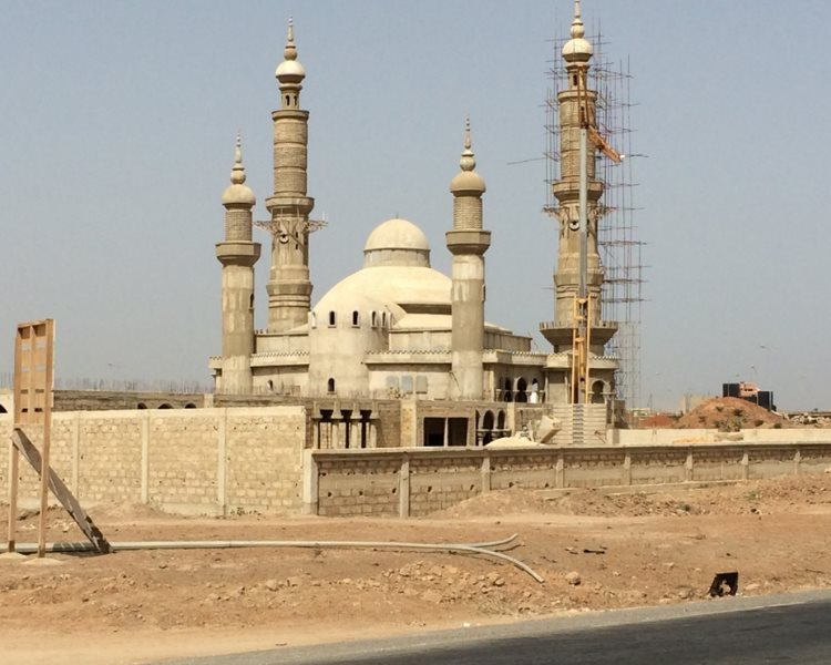 A new mosque going up on the entrance of Dakar