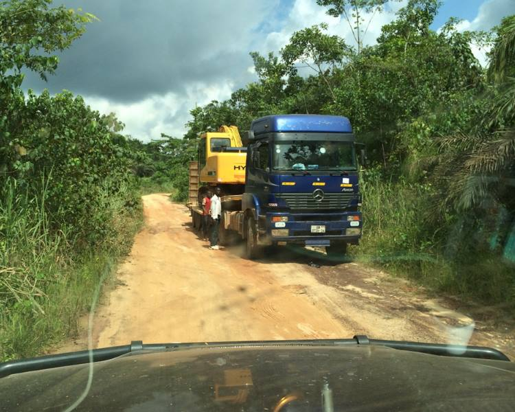 Heavy plant being transported for use in the adjacent gold mines (Ghana)