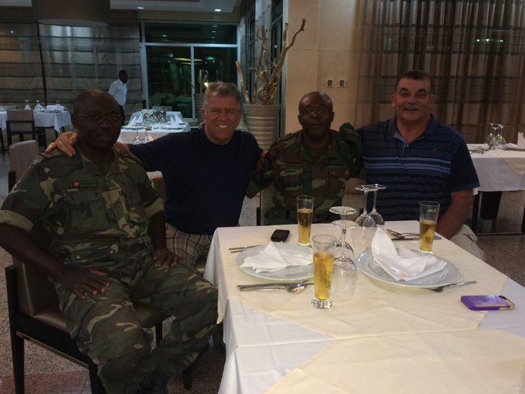Team lipstick with members of the Angolan army