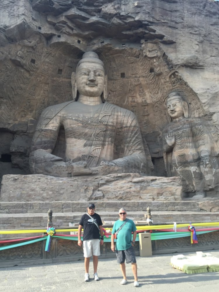 Team Lipstick getting dwarfed by the Buddha carved out off solid rock.