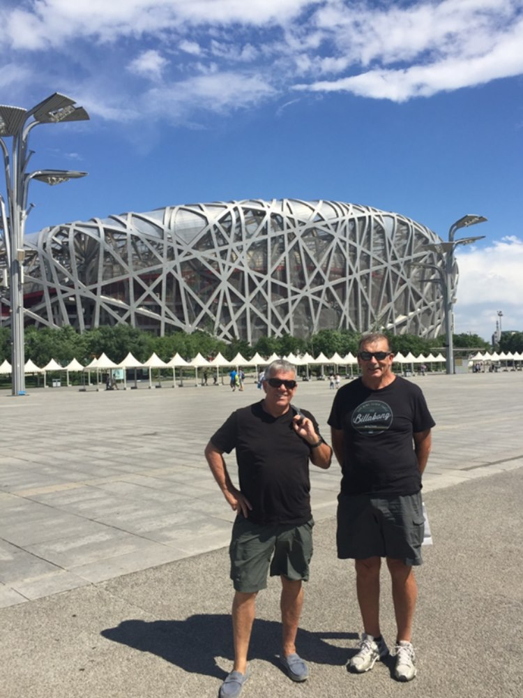 Willy and Andre in front of Beijing's Olympic Stadium..