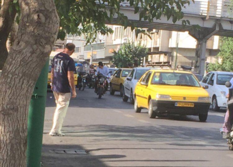Andre successfully waves a taxi down in heavy Teheran traffic...