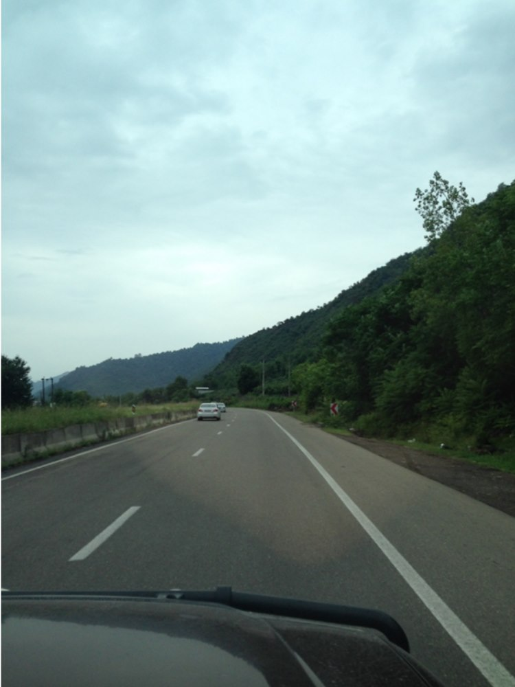 Good roads alongside lots of green with mountains full of trees