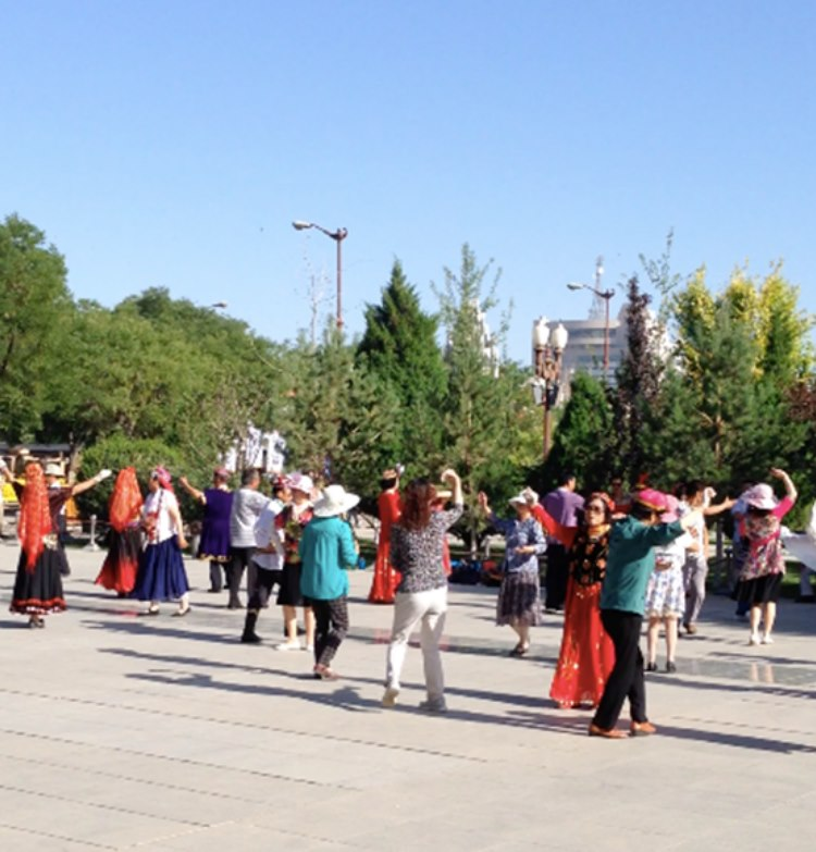 Happy pensioner at 8-30 in the morning in Zhangye dancing on the square